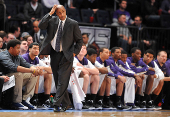 NEW YORK, NY - MARCH 27: Head coach Lorenzo Romar of the Washington Huskies reacts during the final minutes of overtime during his teams game against the Minnesota Golden Golphers during the semifinals of the NIT men's basketball championship at Madison S