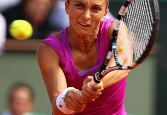 PARIS, FRANCE - JUNE 07:  Sara Errani of Italy plays a backhand in her women's semi final match against Samantha Stosur of Australia during day 12 of the French Open at Roland Garros on June 7, 2012 in Paris, France.  (Photo by Clive Brunskill/Getty Image