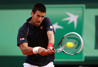 PARIS, FRANCE - JUNE 08:  Novak Djokovic of Serbia plays a backhand in his men's singles semi final match against Roger Federer of Switzerland during day 13 of the French Open at Roland Garros on June 8, 2012 in Paris, France.  (Photo by Clive Brunskill/G