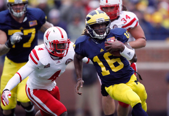ANN ARBOR, MI - NOVEMBER 19:  Denard Robinson #16 of the Michigan Wolverines tries to out run the tackle of Lavonte David #4 of the Nebraska Cornhuskers at Michigan Stadium on November 19, 2011 in Ann Arbor, Michigan. Michigan won the game 45-17. (Photo b