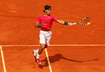 PARIS, FRANCE - JUNE 08:  Rafael Nadal of Spain plays a forehand in his men's singles semi final match against David Ferrer of Spain during day 13 of the French Open at Roland Garros on June 8, 2012 in Paris, France.  (Photo by Clive Brunskill/Getty Image