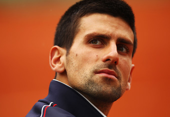 PARIS, FRANCE - JUNE 08:  Novak Djokovic of Serbia looks on prior to his men's singles semi final match against Roger Federer of Switzerland during day 13 of the French Open at Roland Garros on June 8, 2012 in Paris, France.  (Photo by Clive Brunskill/Get