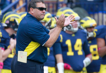 ANN ARBOR, MI - OCTOBER 29: Head coach Brady Hoke cheers on his team from the sideline while playing the Purdue Boilermakers at Michigan Stadium on October 29, 2011 in Ann Arbor, Michigan. Michigan won the game 36-14. (Photo by Gregory Shamus/Getty Images