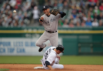 DETROIT, MI - JUNE 01: Derek Jeter #2 of the New York Yankees turns the double play forcing out Danny Worth #29 of the Detroit Tigers in the first inning of the game at Comerica Park on June 1, 2012 in Detroit, Michigan.  (Photo by Leon Halip/Getty Images