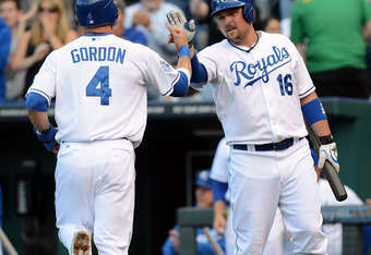KANSAS CITY, MO - JUNE 01:  Alex Gordon #4 of the Kansas City Royals is congratulated by Billy Butler #16 after scoring during the 1st inning of the game against the Oakland Athletics on June 1, 2012 at Kauffman Stadium in Kansas City, Missouri.  (Photo b