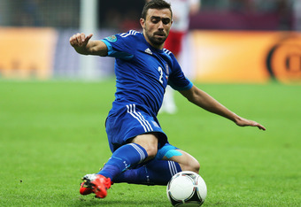 WARSAW, POLAND - JUNE 08:  Giannis Maniatis of Greece on the ball during the UEFA EURO 2012 group A match between Poland and Greece at National Stadium on June 8, 2012 in Warsaw, Poland.  (Photo by Alex Grimm/Getty Images)