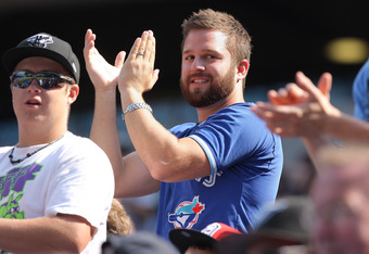 TORONTO, CANADA - AUGUST 27: A fan of the Toronto Blue Jays cheers during MLB game action against the Tampa Bay Rays on August 27, 2011 at Rogers Centre in Toronto, Ontario, Canada. (Photo by Tom Szczerbowski/Getty Images)