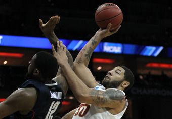 LOUISVILLE, KY - MARCH 15:  Royce White #30 of the Iowa State Cyclones attempts a shot in the seocnd half against Andre Drummond #12 of the Connecticut Huskies during the second round of the 2012 NCAA Men's Basketball Tournament at KFC YUM! Center on Marc
