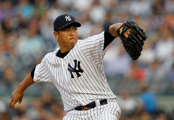 NEW YORK, NY - JUNE 08:  Hiroki Kuroda #18 of the New York Yankees delivers a pitch in the first-inning against the New York Mets at Yankee Stadium on June 8, 2012 in the Bronx borough of New York City.Yankees defeated the Rays 7-0.  (Photo by Mike Stobe/