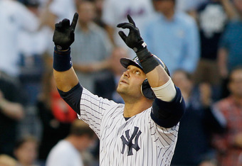 NEW YORK, NY - JUNE 08: Nick Swisher #33 of the New York Yankees points to the sky after hitting a homerun in the third-inning against the New York Mets at Yankee Stadium on June 8, 2012 in the Bronx borough of New York City.  Yankees defeated the Mets 9-