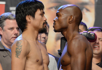 LAS VEGAS, NV - JUNE 08:  Boxers Manny Pacquiao (L) and Timothy Bradley pose during the official weigh-in for their bout at the MGM Grand Garden Arena on June 8, 2012 in Las Vegas, Nevada. Pacquiao will defend his WBO welterweight title against Bradley on