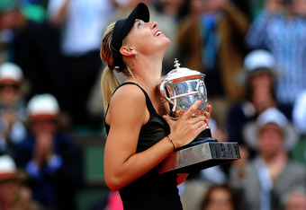 PARIS, FRANCE - JUNE 09:  Maria Sharapova of Russia celebrates with the Coupe Suzanne Lenglen in the women's singles final against Sara Errani of Italy during day 14 of the French Open at Roland Garros on June 9, 2012 in Paris, France.  (Photo by Mike Hew