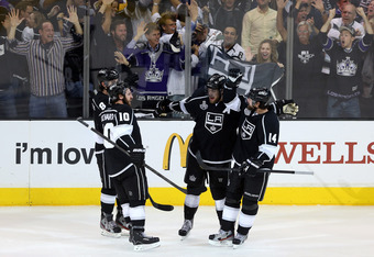 LOS ANGELES, CA - JUNE 06:  Anze Kopitar #11 of the Los Angeles Kings and teammates celebrate Drew Doughty #8 (not pictured) power play goal in the third period of Game Four of the 2012 Stanley Cup Final against New Jersey Devils at Staples Center on June