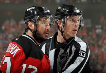 NEWARK, NJ - MAY 21:  Ilya Kovalchuk #17 of the New Jersey Devils talks to a linesman Brian Murphy #93 in Game Four of the Eastern Conference Final against the New York Rangers during the 2012 NHL Stanley Cup Playoffs at the Prudential Center on May 21, 2
