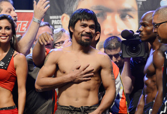 LAS VEGAS, NV - JUNE 08:  Boxers Manny Pacquiao (C) and Timothy Bradley (R) pose during the official weigh-in for their bout at the MGM Grand Garden Arena on June 8, 2012 in Las Vegas, Nevada. Pacquiao will defend his WBO welterweight title against Bradle