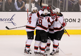 LOS ANGELES, CA - JUNE 06:  Bryce Salvador #24, Anton Volchenkov #28 and Dainius Zubrus #8 of the New Jersey Devils and teammates celebrate Patrik Elias third period goal over the Los Angeles Kings in Game Four of the 2012 Stanley Cup Final at Staples Cen