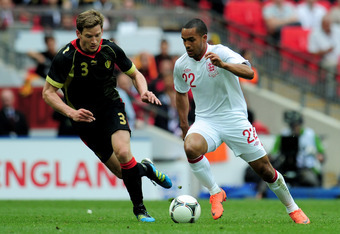LONDON, ENGLAND - JUNE 02:  Theo Walcott of England and Jan Vertonghen of Belgium  in action during the international friendly match between England and Belgium at Wembley Stadium on June 2, 2012 in London, England.  (Photo by Shaun Botterill/Getty Images
