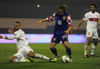 ZAGREB, CROATIA - NOVEMBER 15:  Luka Modric of Croatia battles with Omer Toprak of Turkey during the EURO 2012 qualifier, play off second leg match between Croatia and Turkey at the Zagreb Stadium on November 15, 2011 in Zagreb, Croatia.  (Photo by Jamie