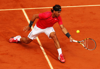 PARIS, FRANCE - JUNE 08:  Rafael Nadal of Spain volleys in his men's singles semi final match against David Ferrer of Spain during day 13 of the French Open at Roland Garros on June 8, 2012 in Paris, France.  (Photo by Clive Brunskill/Getty Images)