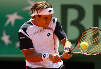 PARIS, FRANCE - JUNE 08:  David Ferrer of Spain plays a backhand in his men's singles semi final match against Rafael Nadal of Spain during day 13 of the French Open at Roland Garros on June 8, 2012 in Paris, France.  (Photo by Clive Brunskill/Getty Image