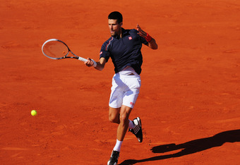 PARIS, FRANCE - JUNE 08:  Novak Djokovic of Serbia plays a forehand in his men's singles semi final match against Roger Federer of Switzerland during day 13 of the French Open at Roland Garros on June 8, 2012 in Paris, France.  (Photo by Mike Hewitt/Getty