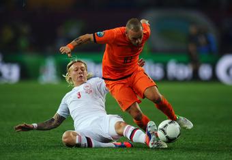 KHARKOV, UKRAINE - JUNE 09:  Simon Kjaer of Denmark tackles Wesley Sneijder of Netherlands during the UEFA EURO 2012 group B match between Netherlands and Denmark at Metalist Stadium on June 9, 2012 in Kharkov, Ukraine.  (Photo by Lars Baron/Getty Images)