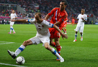 WROCLAW, POLAND - JUNE 08:  Tomas Sivok of Czech Republic and Alan Dzagoev of Russia fight for the ball during the UEFA EURO 2012 group A match between Russia and Czech Republic at The Municipal Stadium on June 8, 2012 in Wroclaw, Poland.  (Photo by Chris