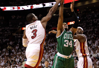 MIAMI, FL - JUNE 09:  Paul Pierce #34 of the Boston Celtics goes up for a shot between Dwyane Wade #3 and LeBron James #6 of the Miami Heat in the first quarter in Game Seven of the Eastern Conference Finals in the 2012 NBA Playoffs on June 9, 2012 at Ame