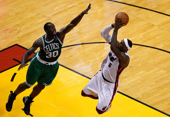 MIAMI, FL - JUNE 09:  LeBron James #6 of the Miami Heat shoots over Brandon Bass #30 of the Boston Celtics in Game Seven of the Eastern Conference Finals in the 2012 NBA Playoffs on June 9, 2012 at American Airlines Arena in Miami, Florida. NOTE TO USER: