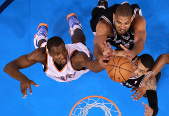 OKLAHOMA CITY, OK - JUNE 02:  Serge Ibaka #9 of the Oklahoma City Thunder goes up for a rebound alongside Tim Duncan #21 and Danny Green #4 of the San Antonio Spurs in the second half in Game Four of the Western Conference Finals of the 2012 NBA Playoffs