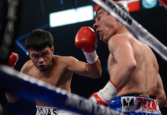 LAS VEGAS, NV - JUNE 09:  (L-R) Jesus Rojas lands a left to the head of Jorge Arce during their featherweight fight at MGM Grand Garden Arena on June 9, 2012 in Las Vegas, Nevada.  (Photo by Kevork Djansezian/Getty Images)