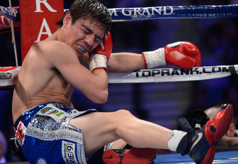 LAS VEGAS, NV - JUNE 09:  Jorge Arce winces in pain after suffering an unintentional foul from Jesus Rojas during their featherweight fight at MGM Grand Garden Arena on June 9, 2012 in Las Vegas, Nevada.  (Photo by Kevork Djansezian/Getty Images)
