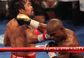 LAS VEGAS, NV - JUNE 09:  (L-R) Manny Pacquiao and Timothy Bradley exchange punches during their WBO welterweight title fight at MGM Grand Garden Arena on June 9, 2012 in Las Vegas, Nevada.  (Photo by Jeff Bottari/Getty Images)