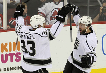 NEWARK, NJ - JUNE 09: Justin Williams #14 of the Los Angeles Kings celebrates with Willie Mitchell #33 after Williams scores a goal in the second period against the New Jersey Devils during Game Five of the 2012 NHL Stanley Cup Final at the Prudential Cen