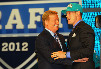 NEW YORK, NY - APRIL 26:  Ryan Tannehill from Texas A&M holds greets NFL Commissioner Roger Goodell after he was selected #8 overall by the Miami Dolphins in the first round of during the 2012 NFL Draft at Radio City Music Hall on April 26, 2012 in New Yo