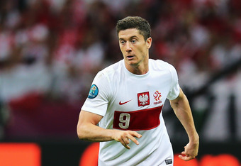 WARSAW, POLAND - JUNE 08:  Robert Lewandowski of Poland in action during the UEFA EURO 2012 group A match between Poland and Greece at National Stadium on June 8, 2012 in Warsaw, Poland.  (Photo by Alex Grimm/Getty Images)