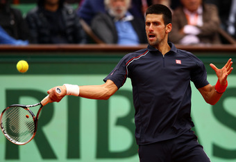PARIS, FRANCE - JUNE 10:  Novak Djokovic of Serbia plays a forehand during the men's singles final against Rafael Nadal of Spain on day 15 of the French Open at Roland Garros on June 10, 2012 in Paris, France.  (Photo by Clive Brunskill/Getty Images)