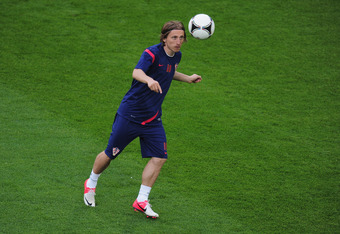 POZNAN, POLAND - JUNE 09:  Luka Modric of Croatia controls the ball during a Croatia training session prior to tomorrows UEFA EURO 2012 Group C match against Ireland at Municipal Stadium on June 9, 2012 in Poznan, Poland.  (Photo by Jamie McDonald/Getty I