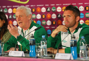 POZNAN, POLAND - JUNE 09:  In this handout image provided by UEFA, Robbie Keane and Giovanni Trapattoni of Republic of Ireland talk to the press during a UEFA EURO 2012 press conference ahead of the UEFA EURO 2012 Group C match between Republic of Republi