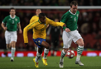 LONDON, ENGLAND - MARCH 02:  Robinho (L) of Brazil contests with Glenn Whelan of Ireland during the International Friendly match between Republic of Ireland and Brazil played at Emirates Stadium on March 2, 2010 in London, England.  (Photo by Hamish Blair