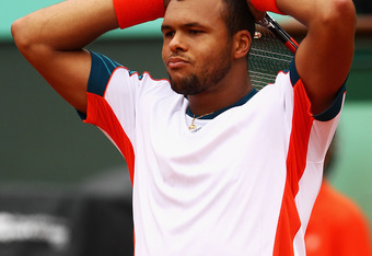 PARIS, FRANCE - JUNE 05:  Jo-Wilfried Tsonga of France looks dejected in his men's singles quarter final match against Novak Djokovic of Serbia during day 10 of the French Open at Roland Garros on June 5, 2012 in Paris, France.  (Photo by Clive Brunskill/