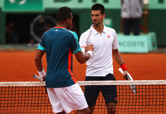 PARIS, FRANCE - JUNE 05:  Novak Djokovic of Serbia shakes hands with Jo-Wilfried Tsonga of France after their men's singles quarter final match during day 10 of the French Open at Roland Garros on June 5, 2012 in Paris, France.  (Photo by Clive Brunskill/
