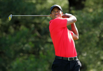 DUBLIN, OH - JUNE 03:  Tiger Woods hits his tee shot on the par 4 17th hole during the final round of the Memorial Tournament presented by Nationwide Insurance at Muirfield Village Golf Club on June 3, 2012 in Dublin, Ohio.  (Photo by Andy Lyons/Getty Ima