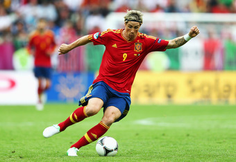 GDANSK, POLAND - JUNE 10:  Fernando Torres of Spain with the ball during the UEFA EURO 2012 group C match between Spain and Italy at The Municipal Stadium on June 10, 2012 in Gdansk, Poland.  (Photo by Michael Steele/Getty Images)