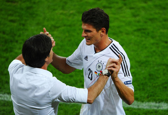 L'VIV, UKRAINE - JUNE 09:  Mario Gomez of Germany hugs Head Coach Joachim Loew of Germany during the UEFA EURO 2012 group B match between Germany and Portugal at Arena Lviv on June 9, 2012 in L'viv, Ukraine.  (Photo by Laurence Griffiths/Getty Images)