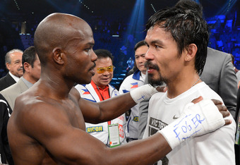 LAS VEGAS, NV - JUNE 09:  (L-R) Timothy Bradley and Manny Pacquiao talk in the ring after Bradley defeated Pacquiao by split decision to win the WBO welterweight championship at MGM Grand Garden Arena on June 9, 2012 in Las Vegas, Nevada.  (Photo by Kevor