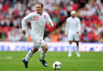 Wayne Rooney dribbles the ball in an International Friendly. The English talent has been held without a goal in his last two matches with England.