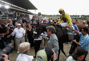 ELMONT, NY - JUNE 09: Jockey John Velazquez takes Union Rags into the winners circle after winning the 144th Belmont Stakes at Belmont Park on June 9, 2012 in Elmont, New York.  (Photo by Rob Carr/Getty Images)