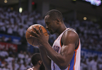 OKLAHOMA CITY, OK - JUNE 06:  Serge Ibaka #9 of the Oklahoma City Thunder touches the ball before a free throw against the San Antonio Spurs in Game Six of the Western Conference Finals in the 2012 NBA Playoffs on June 6, 2012 at the Chesapeake Energy Are