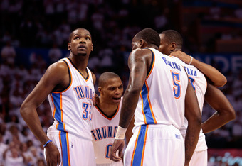 OKLAHOMA CITY, OK - JUNE 06:  Russell Westbrook #0 of the Oklahoma City Thunder talks with teammates Kevin Durant #35, Serge Ibaka #9 and Kendrick Perkins #5 against the San Antonio Spurs in Game Six of the Western Conference Finals of the 2012 NBA Playof